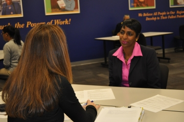 A volunteer working with a Goodwill student on a mock interview