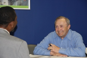 Volunteer Dan Zacharski offers resume advice to a workshop participant