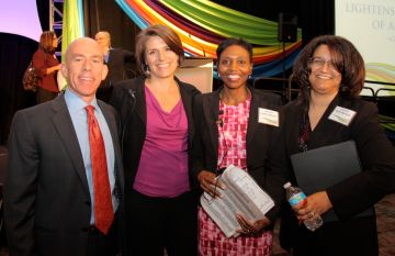 Jay Norvell, Goodwill board member and Diversity & Inclusion Strategy Consultant for Technology & Operations at Wells Fargo, poses with Goodwill staff Genny Ryan, Cheryl Brown and Kilby Watson