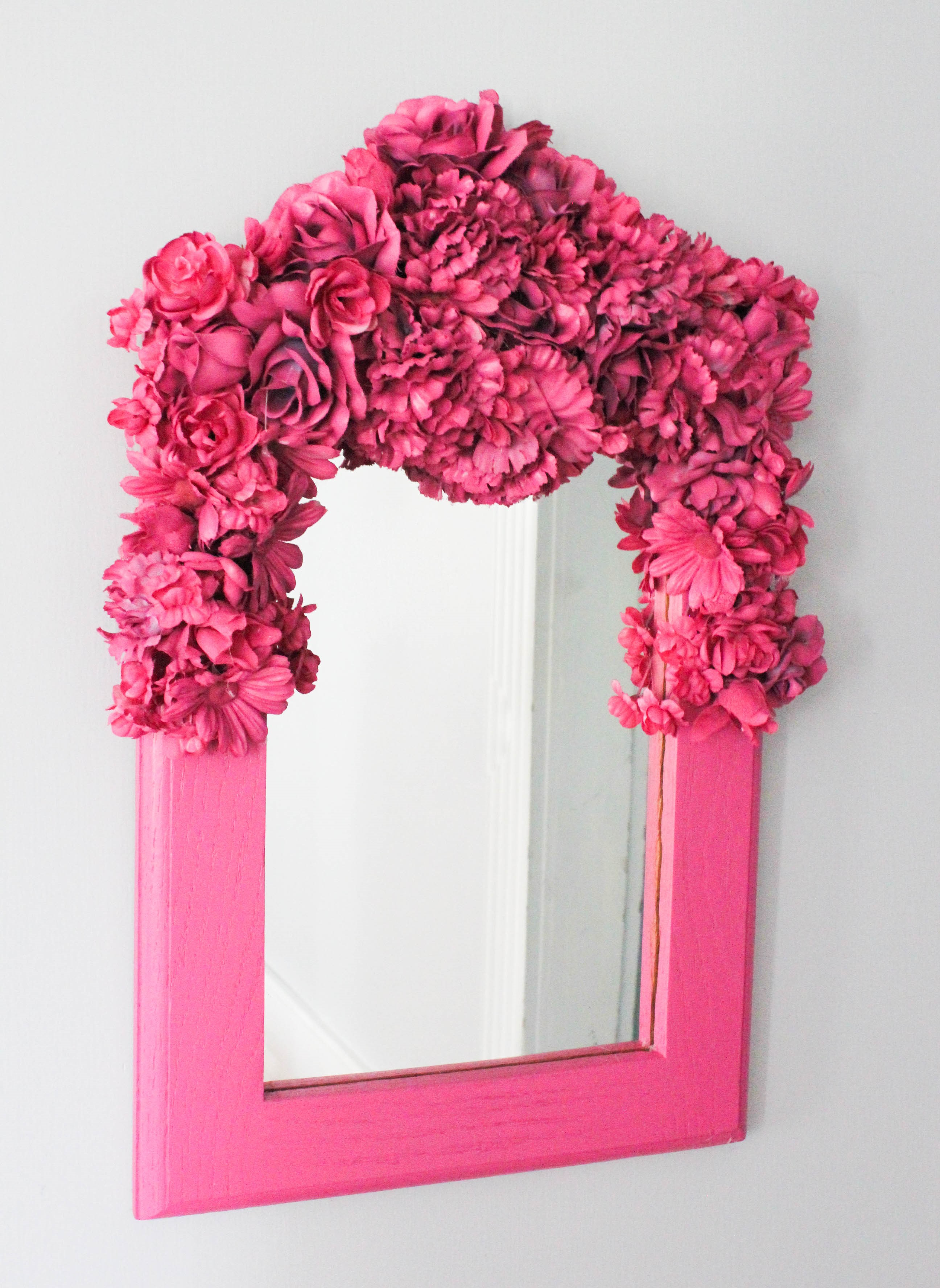 Transform a plain mirror with flowers and spray paint wow goodwill 1 mirror with silk flowers spray paint mightylinksfo